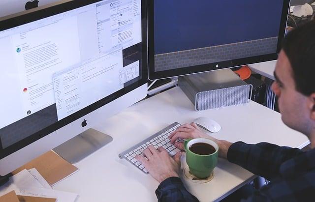 Digital marketer at his desk (benefits of building customer relationships)
